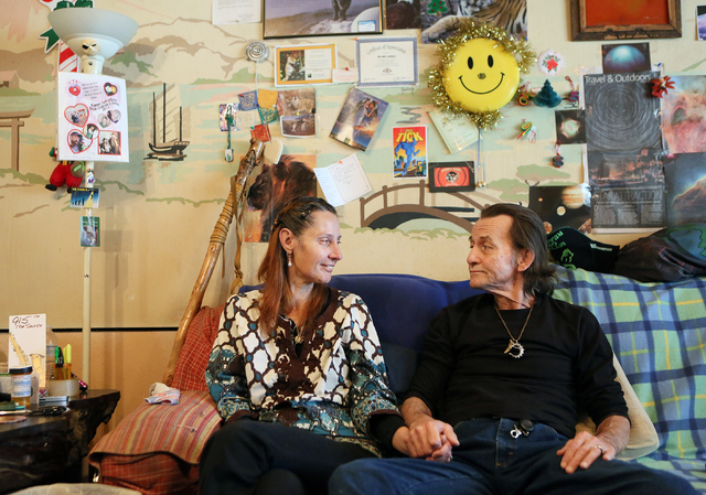 Monica Gamble, left, sits with her husband, William, in their home, Jan. 19. (Ronda Churchill/View)