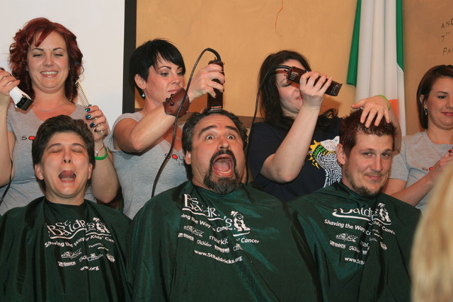 Alex Raffi, center, shaves his head with fellow teammates at a St. Baldrick's Day event in March 2011 at McMullan's Irish Pub, 4650 W. Tropicana Ave. (Tiffannie Bond/Special to View)