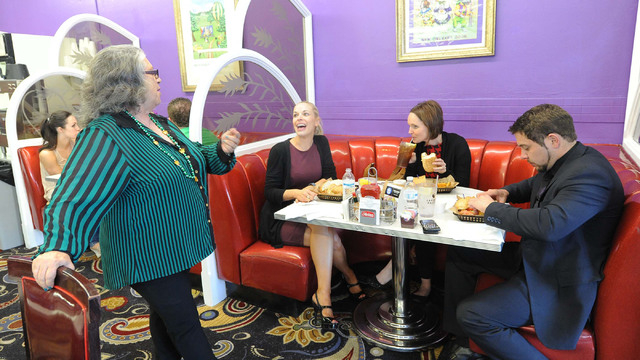 Streetcar Po-boys owner Gwen Bartholomew, left, chats with Mrs. Las Vegas Katie Ladomerszky, second left, and her Cosmopolitan of Las Vegas co-workers Erin Naeve and Zachary Smith at the restauran ...