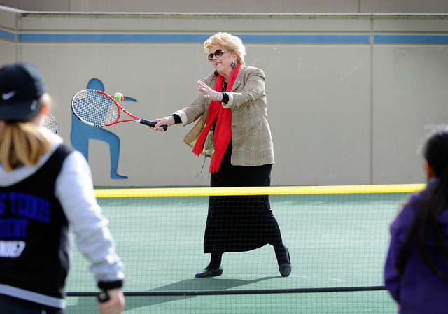 Las Vegas Mayor Carolyn Goodman, center, returns a volley against Rocco Mendez, left, and Natalie Cheong during a demonstration after a news conference announcing Las Vegas' newest professional sp ...