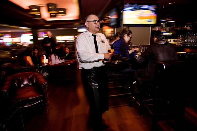 Juan Villalpando serves beverages at Tender Steak & Seafood restaurant in the Luxor hotel-casino in Las Vegas on Saturday, Feb. 8 2014. (Jeferson Applegate/Las Vegas Review-Journal)