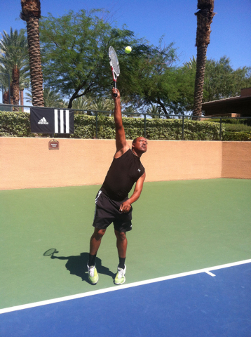 Richman Mahlangu practices on the tennis court. Mahlangu recently published a book about how tennis helped him escape apartheid in South Africa. (Special to View)