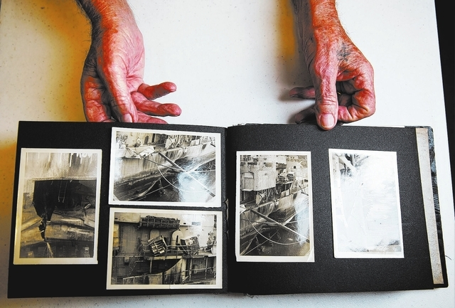 Calvin Pascetta (cq), 90, shows photos from his career in the Navy inside his North Las Vegas home Monday, Feb. 3, 2014. Pascetta's 30-year career in the Navy spanned from World War II, the Korea  ...