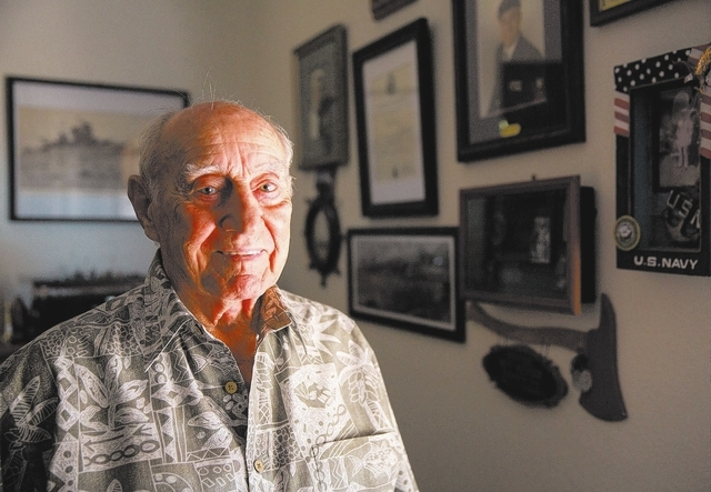 Calvin Pascetta (cq), 90, poses inside his North Las Vegas home Monday, Feb. 3, 2014. Pascetta's 30-year career in the Navy spanned from World War II, the Korea War and the Vietnam War before he r ...