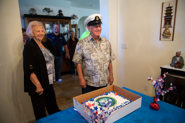 Calvin Pascetta (cq), center, wears his old sailor hat while his sister, Jay Petrelli (cq), left, looks on during Pascetta's 90th birthday inside his North Las Vegas home Monday, Feb. 3, 2014. Pas ...