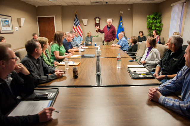 One Nevada Credit Union President and CEO, Brad Beal, center, speaks to his employees during a team meeting at the One Nevada Credit Union home offices in Las Vegas, Thursday, Jan. 16, 2014. (Mart ...