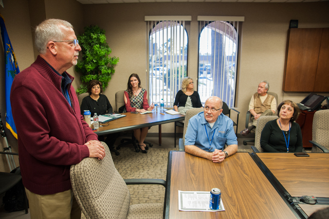 One Nevada Credit Union President and CEO, Brad Beal, left, speaks to his employees during a team meeting at the One Nevada Credit Union home offices in Las Vegas, Thursday, Jan. 16, 2014. (Martin ...