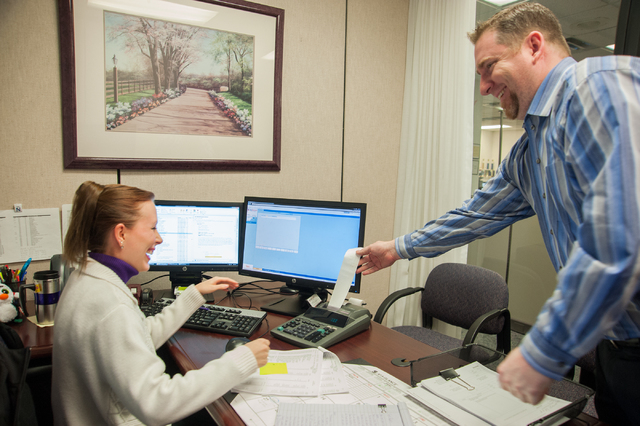 One Nevada Credit Union employees Julianna Gates, left, and Steve O'Donnell interact inside the One Nevada Credit Union home offices in Las Vegas, Thursday, Jan. 16, 2014. (Martin S. Fuentes/Las V ...