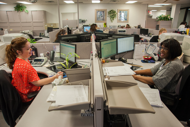 One Nevada Credit Union employees Allison Brown, left, and Rose Dreighton interact inside the One Nevada Credit Union home offices in Las Vegas, Thursday, Jan. 16, 2014. (Martin S. Fuentes/Las Veg ...