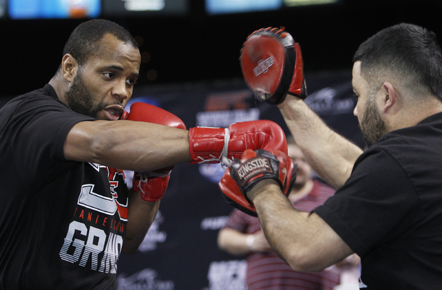 Daniel Cormier, left, shown working out with Rosendo Sanchez on Tuesday at Mandalay Bay, readily accepted a fight on short notice with Patrick Cummins in UFC 170 on Saturday, not wanting to waste  ...