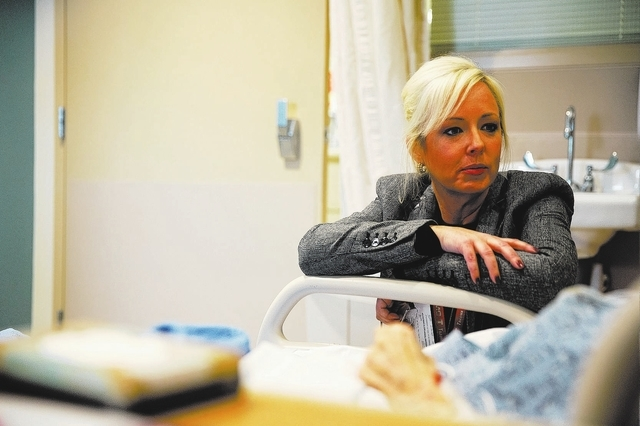 Cara Goodman introduces herself to a patient with second-degree burns at UMC on Thursday, Jan. 23, 2014. Goodman, a marriage and family therapist and daughter of Mayor Carolyn Goodman, began volun ...