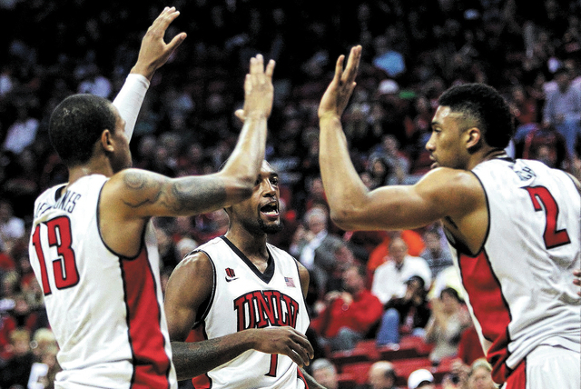 UNLV's Bryce Dejean-Jones (13), Khem Birch (2) and Roscoe Smith (1) come together after scoring against Utah State during their basketball game at the Thomas & Mack Center in Las Vegas on Wednesda ...