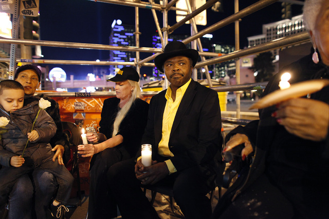 From left, Aaron Michael Herbert Boldon, Sheila Richardson, Diana Fennell, Tehran Boldon and Clara Jenkins hold a vigil along The Strip in Las Vegas Thursday, Feb. 20, 2014. Tehran Boldon is the b ...