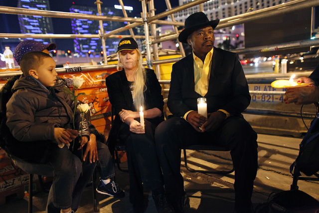From left, Aaron Michael Herbert Boldon, Sheila Richardson (behind Boldon), Diana Fennell and Tehran Boldon hold a vigil along The Strip in Las Vegas Thursday, Feb. 20, 2014. Tehran Boldon is the  ...