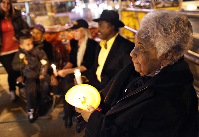 Clara Jenkins, right, and others hold a vigil along The Strip in Las Vegas Thursday, Feb. 20, 2014. (John Locher/Las Vegas Review-Journal)