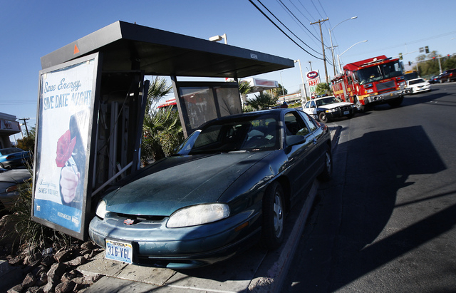 A car is seen crashed into a bus stop on the southwest corner of Decatur and Washington in Las Vegas on Oct. 18, 2013. The driver of the car, who asked to remain nameless, claimed to be distracted ...