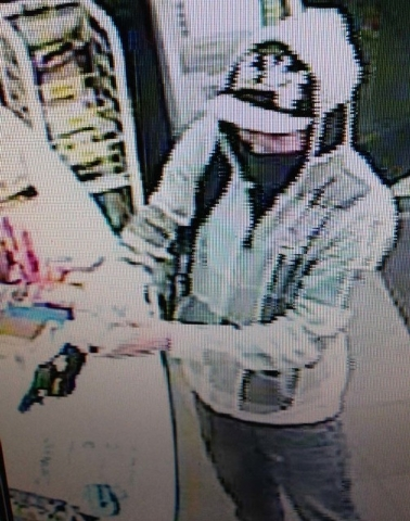 Las Vegas police are looking for information on two suspects who robbed a business at gunpoint near Sahara and Sloan avenues on Jan. 23. Anyone with information is urged to call Las Vegas police a ...