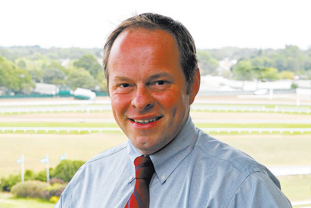 Larry Collmus, shown in 2010, is the new announcer at Churchill Downs, continuing a long climb to the top of his profession. (AP Photo/EQUI-PHOTO, Bill Denver)