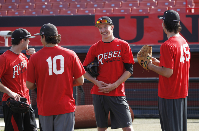 UNLV pitcher Erick Fedde, middle, talks with some teammates during an organized team activity at WIlson Stadium in Las Vegas on Tuesday, Feb. 11, 2014. (Jason Bean/Las Vegas Review-Journal)