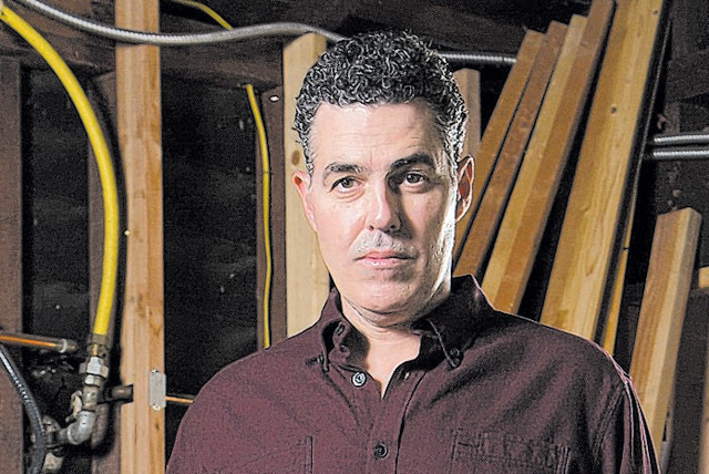 "Adam Carolla is on the set of his new Spike TV show ""Catch a Contractor,"" debuting March 9. Carolla will return to Vegas on Friday to stage his podcast at the Treasure Island Theatre. (Courtesy)"