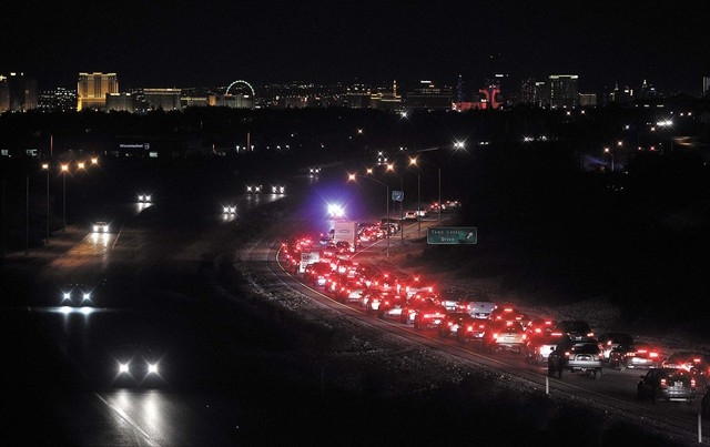 Eastbound traffic on Summerlin Parkway is diverted off the freeway at Town Center Drive after a double fatal crash near Rampart Boulevard Wednesday, Feb. 5, 2014. (K.M. Cannon/Las Vegas Review-Jou ...