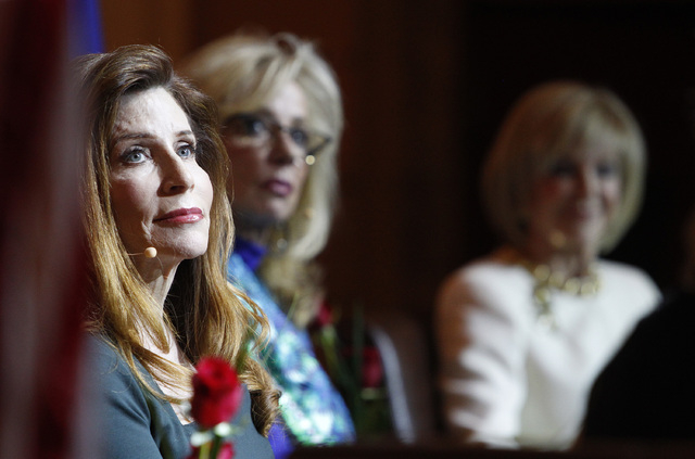 Patricia Becker, left, sits on the stage with Jan Jones Blackhurst and Elaine Wynn at the Women in Gaming event at the Mob Museum on Wednesday. (John Locher/Las Vegas Review-Journal)