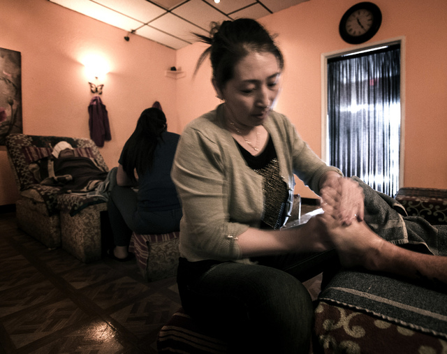 Sophis Zhou gives a costumer a foot massage at Happy Feet, 4970 Arville Street, on Wednesday, Jan. 22, 2014. Clark County commissioners voted Tuesday to regulate reflexologists more closely, with  ...