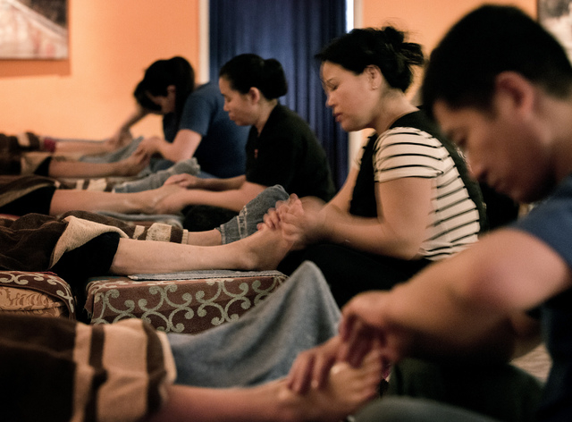 Sam Li, right, and Tracy Zhang gives a costumers a foot massage at Happy Feet, 4970 Arville Street, on Wednesday, Jan. 22, 2014. Clark County commissioners voted Tuesday to regulate reflexologists ...