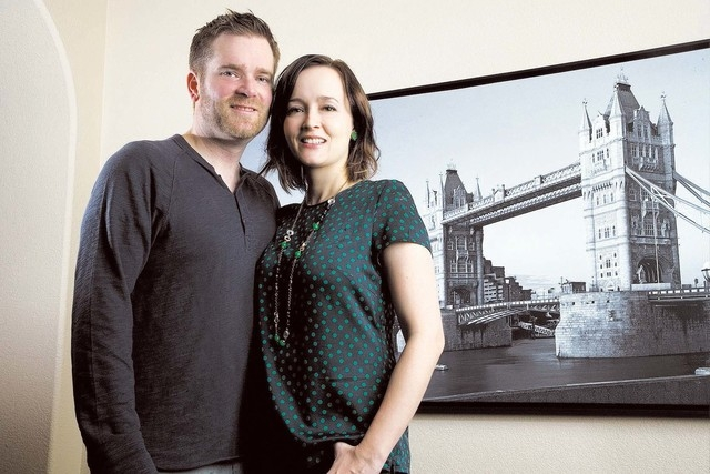 Josh and Rachel Harris pose in front of a photo of the Tower of London in their Las Vegas home Saturday, Feb. 1, 2014. It was at the Tower of London where Josh proposed to Rachel. (Jeferson Appleg ...