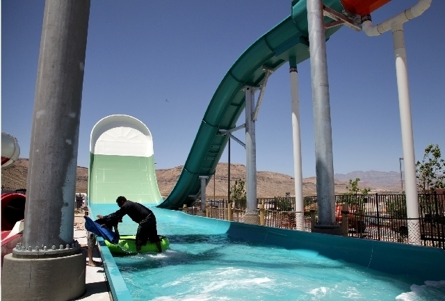 Anthony Contreras, an employee of Whitewater, tests weight limits during high winds in May 2013 by floating a raft filled with water weights on the Hoover Half Pipe ride at Wet 'n' Wild. The park  ...