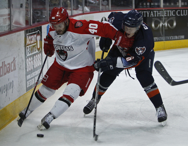 Carlo Finucci, left, of the Wranglers skates by Matt Clune of the Ontario Reign during their hockey game at the Orleans Arena in Las Vegas Saturday, Jan. 4, 2014.  (John Locher/Las Vegas Review-Jo ...