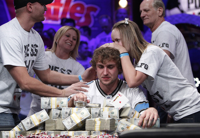 Ryan Riess celebrates with his family after winning the World Series of Poker at the Rio in Las Vegas Tuesday, Nov. 5, 2013. (John Locher/Las Vegas Review-Journal)