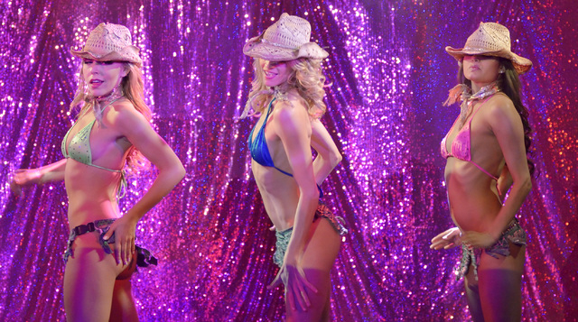 "Whitney Giron, left, Stephanie Smith, center, and Shakeera Onstead perform during ""X Burlesque"" in the X Showroom at the Flamingo hotel-casino at 3555 Las Vegas Blvd., South, in Las Vega ..."