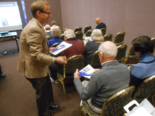 Ed McDougall, representative for Smith & Nephew Inc., hands out papers explaining hip replacement surgery Jan. 9 at Sun City Summerlin's Desert Vista Community Center, 10360 Sun City Blvd., before ...
