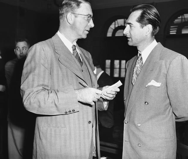 Sen. Estes Kefauver (D-Tenn), left, talks with the lieutenant governor of Nevada, Cliff Jones d ...