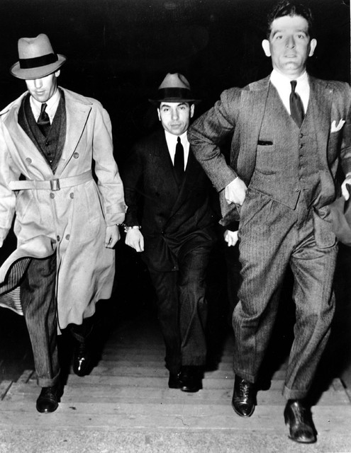 """Charles """"Lucky"""" Luciano, center, is escorted into court by two detectives on June 18, 1936. Luc ..."""