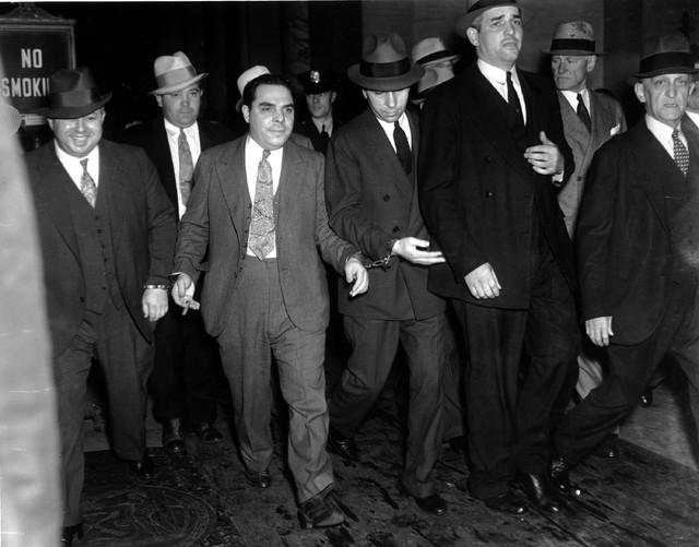 """Charles """"Lucky"""" Luciano convicted of vice charges, is leaving court on June 18, 1936 ..."""
