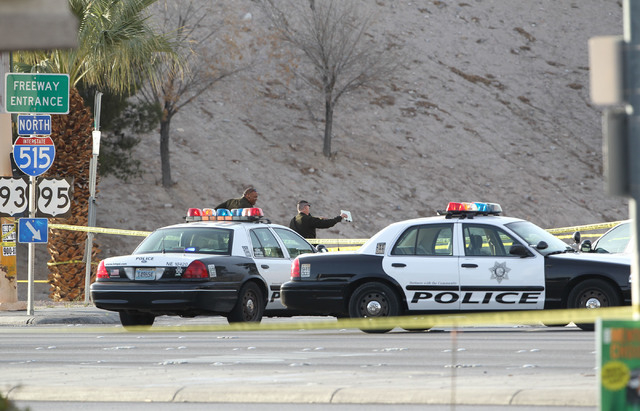 Police gather near the scene of an officer involved shooting on the northbound onramp of US Highway 95 that closed Charleston Blvd. in both directions on Monday March 3, 2014. (K.M. Cannon/Las Veg ...