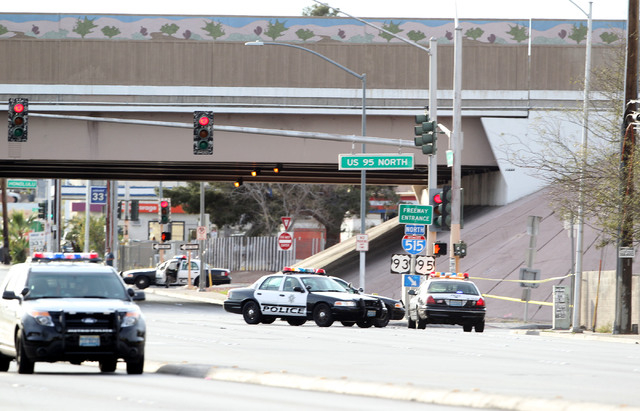Police gather near the scene of an officer involved shooting on the northbound onramp of US Highway 95 that closed Charleston Blvd. in both directions on Monday March 3, 2014.  (K.M. Cannon/Las Ve ...