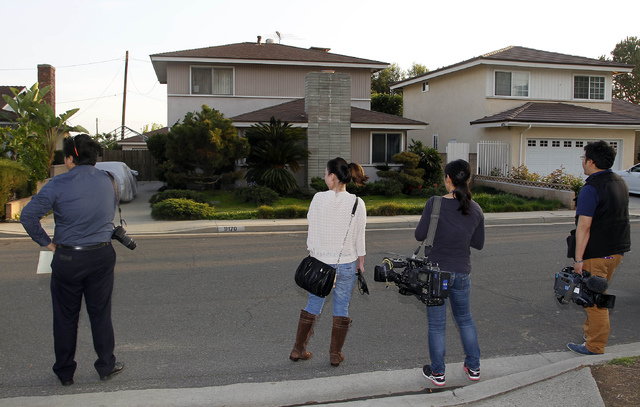 Japanese media wait outside the residence, left, of Dorian S. Nakamoto Thursday March 6, 2014, in Temple City, Calif. Nakamoto, the man that Newsweek claims is the founder of Bitcoin denies he had ...