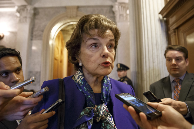 Senate Intelligence Committee Chair Sen. Dianne Feinstein, D-Calif. talks to reporters as she leaves the Senate chamber on Capitol Hill in Washington, Tuesday, March 11, 2014, after saying that th ...