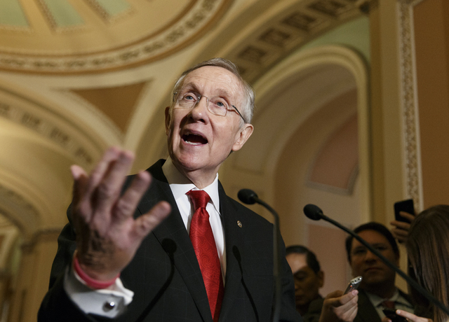 Senate Majority Leader Harry Reid of Nev., faces reporters on Capitol Hill in Washington, Tuesday, March 11, 2014, following a caucus lunch. Reid said that he stands behind Senate Intelligence Com ...