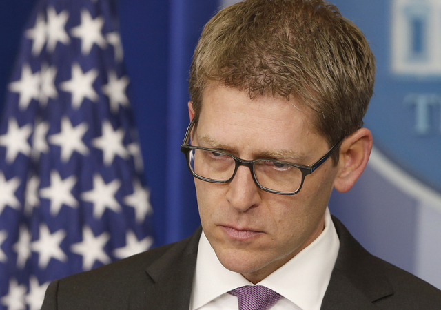 White House press secretary Jay Carney listens as he briefs reporters at the White House in Washington, Tuesday, March 11, 2014. Carney took questions about allegations that the CIA searched compu ...