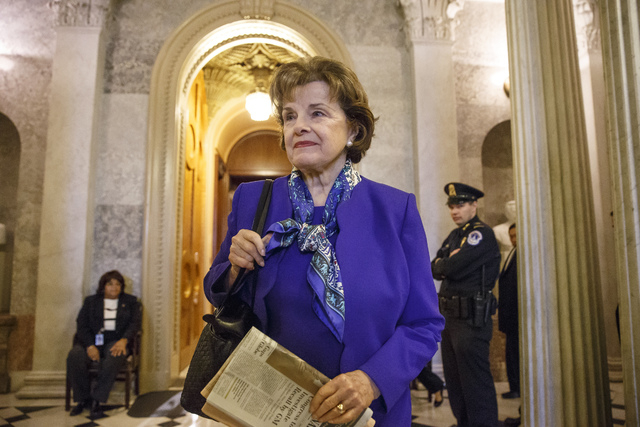 Senate Intelligence Committee Chair Sen. Dianne Feinstein, D-Calif. leaves the Senate chamber on Capitol Hill in Washington, Tuesday, March 11, 2014, after saying that the CIA's improper search of ...