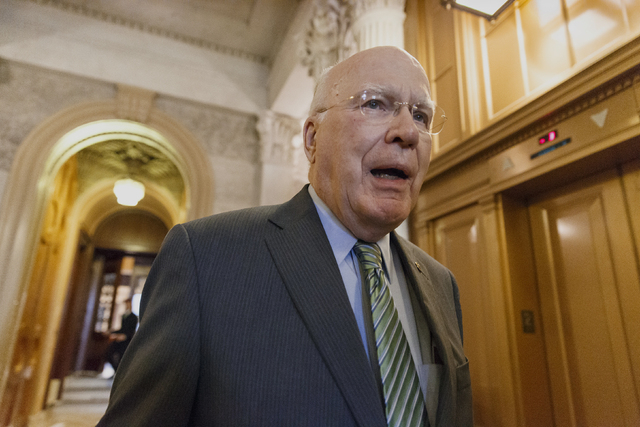 Senate Judiciary Committee Chairman Sen. Patrick Leahy, D-Vt. leaves the Senate chamber on Capitol Hill in Washington, Tuesday, March 11, 2014, after speaking in support of Senate Intelligence Com ...