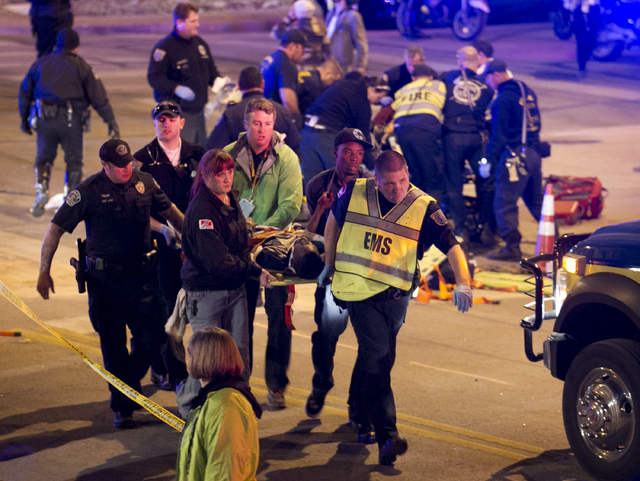A patient is carried away after being struck by a vehicle early Thursday morning in Austin, Texas, during the South By Southwest festival. Police say two people were confirmed dead at the scene af ...