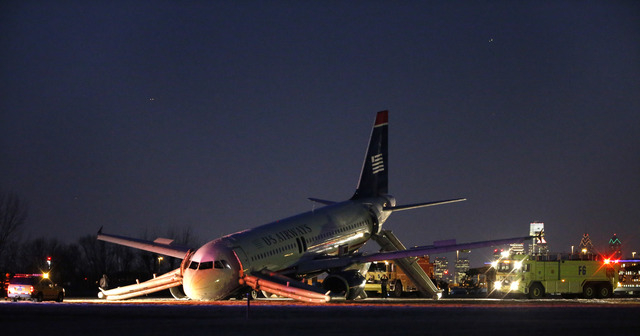 A damaged US Airways jet lies at the end of a runway at the Philadelphia International Airport on Thursday. Airline officials said the flight was heading to Fort Lauderdale, Fla., when the pilot w ...