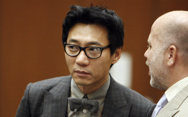 Young Lee, one of the former founders of the Pinkberry yogurt chain stands with his attorney Philip Kent Cohen, right, during his arraignment in the Los Angeles Criminal Courts Building in Los Ang ...