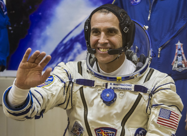 U.S. astronaut Rick Mastracchio, a crew member of the International Space Station, waves prior to the launch of Soyuz-FG rocket Nov. 7 at the Russian-leased Baikonur cosmodrome, Kazakhstan. Mastra ...