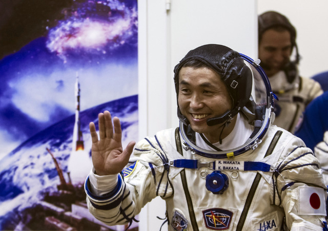 Koichi Wakata, a crew member of the International Space Station, is shown before the launch of Soyuz-FG rocket on Nov. 7 at the Russian-leased Baikonur cosmodrome, Kazakhstan. Wakata and U.S. astr ...